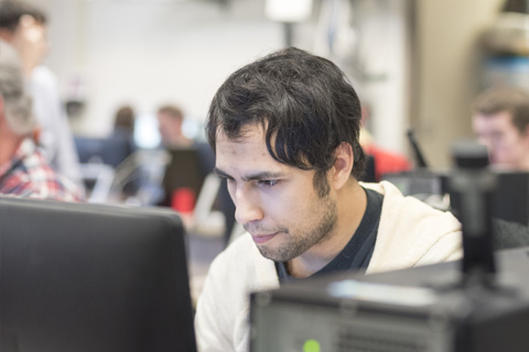 Estefan working in a computer lab.