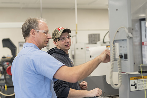 Terry Morse working with a student in Delta's CNC lab