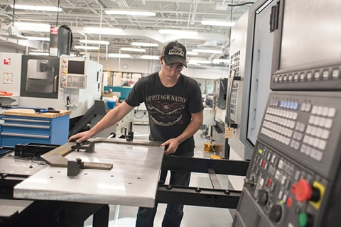 Student working on CNC equipment