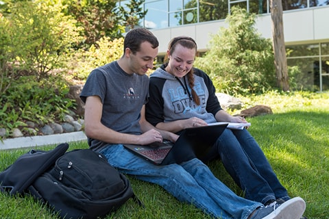 Students on laptop in Courtyard