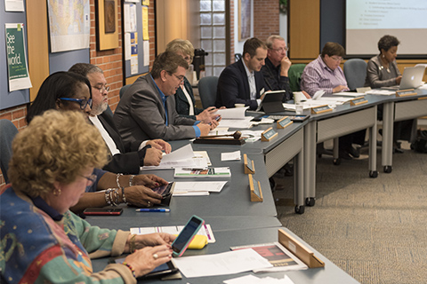 Board of Trustees at a meeting
