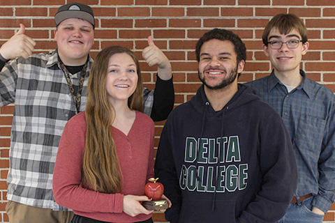 Students with the Collegiate Apple Award