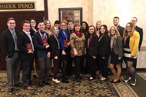 group of deca students from regional competition