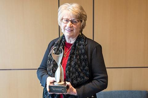 Dr. Goodnow with Athena Award