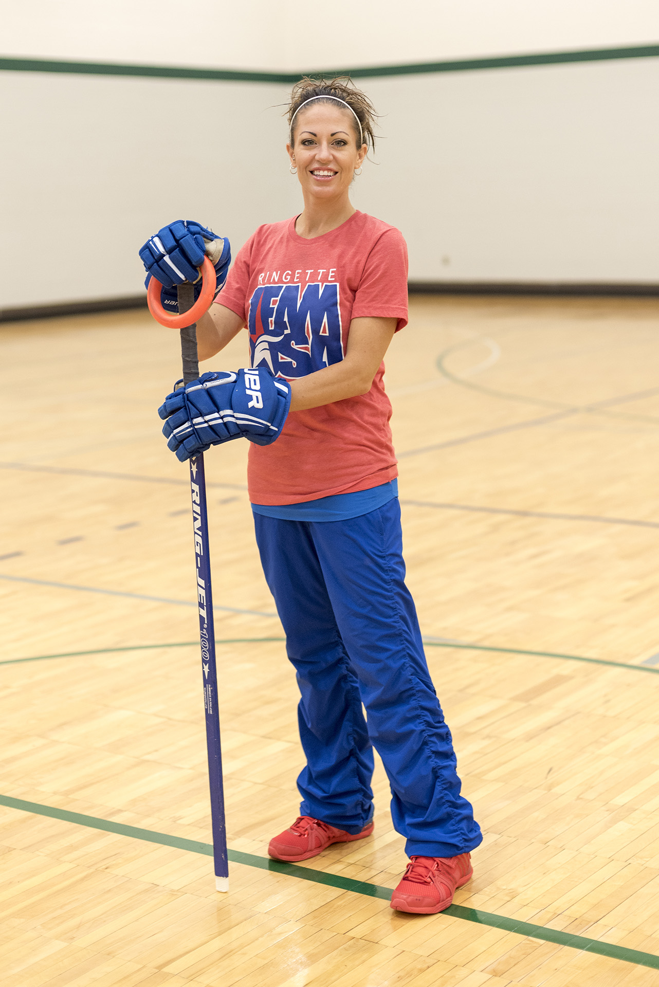 Renee Hoppe in gym with ringette gear
