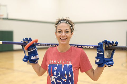 Renee Hoppe with ringette gear.