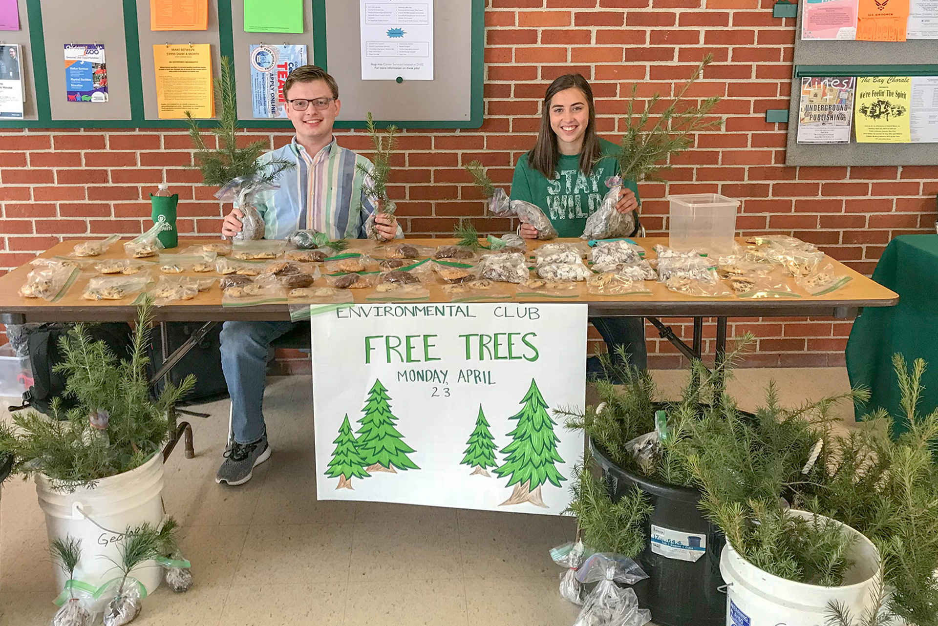 Students giving away tree seedlings on Earth Day