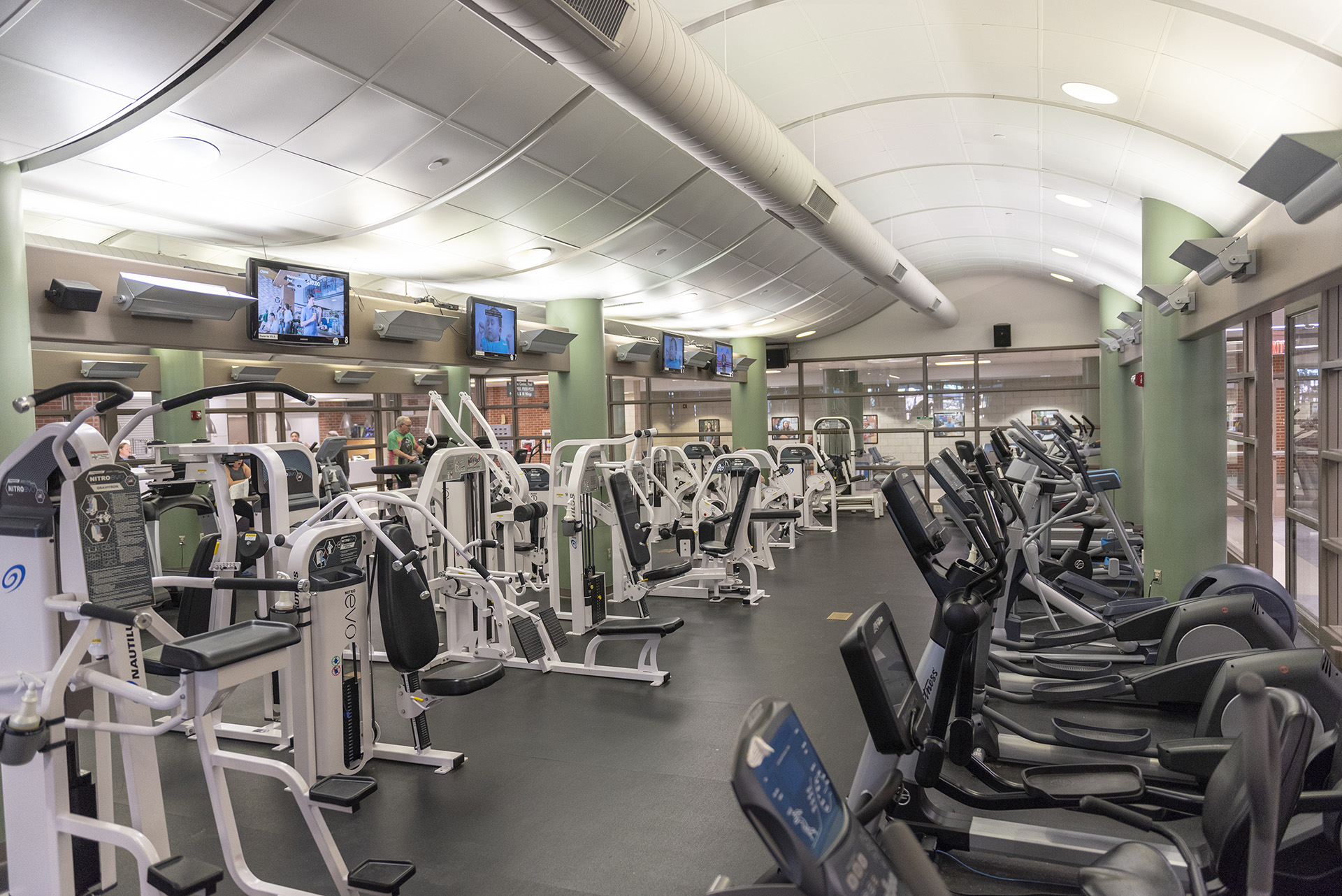 The cardio room has treadmills, ellipticals, weight machines and more.
