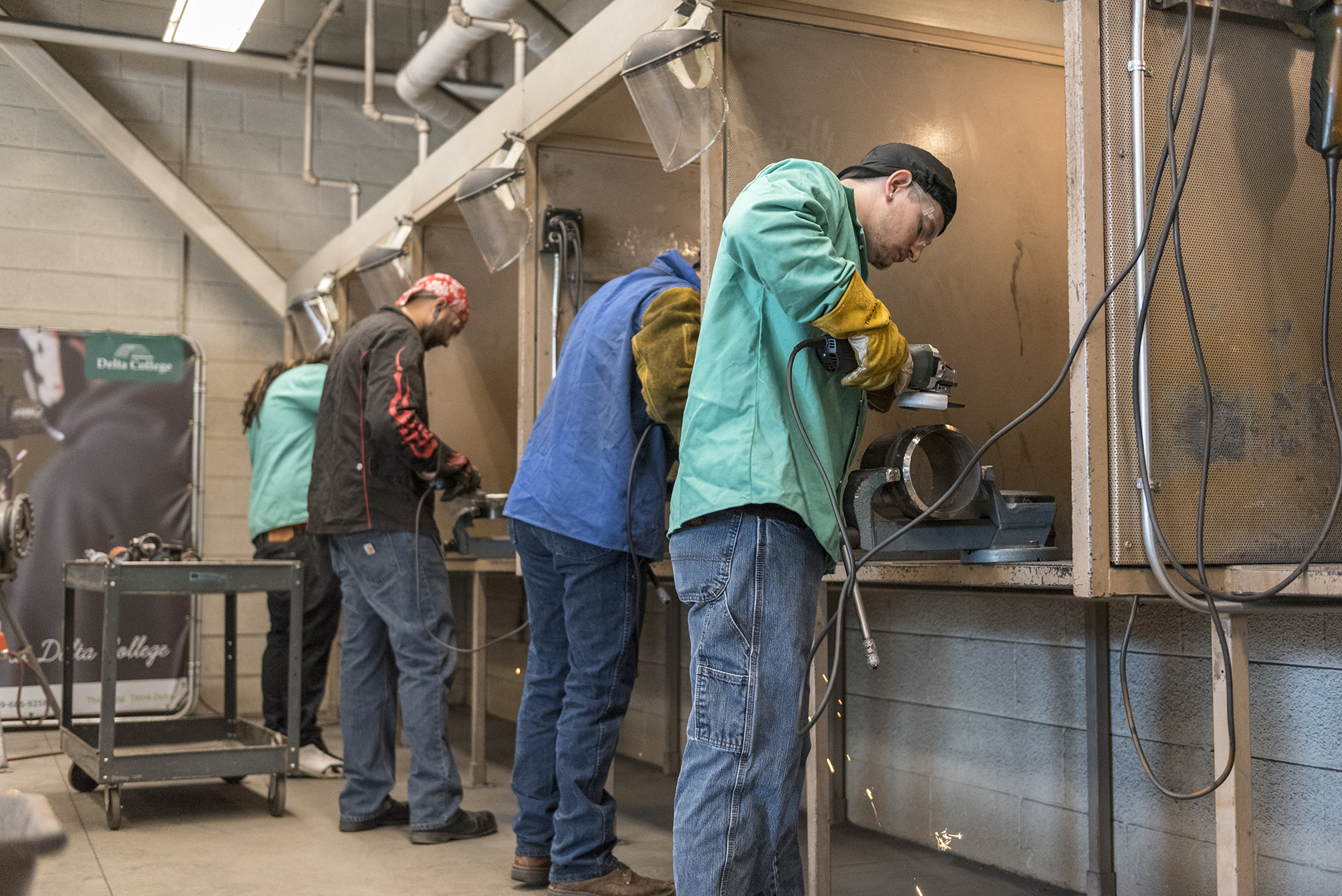 Students practice their hand welding skills in the welding lab.