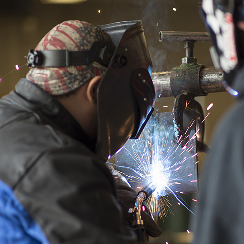 Students practicing welding