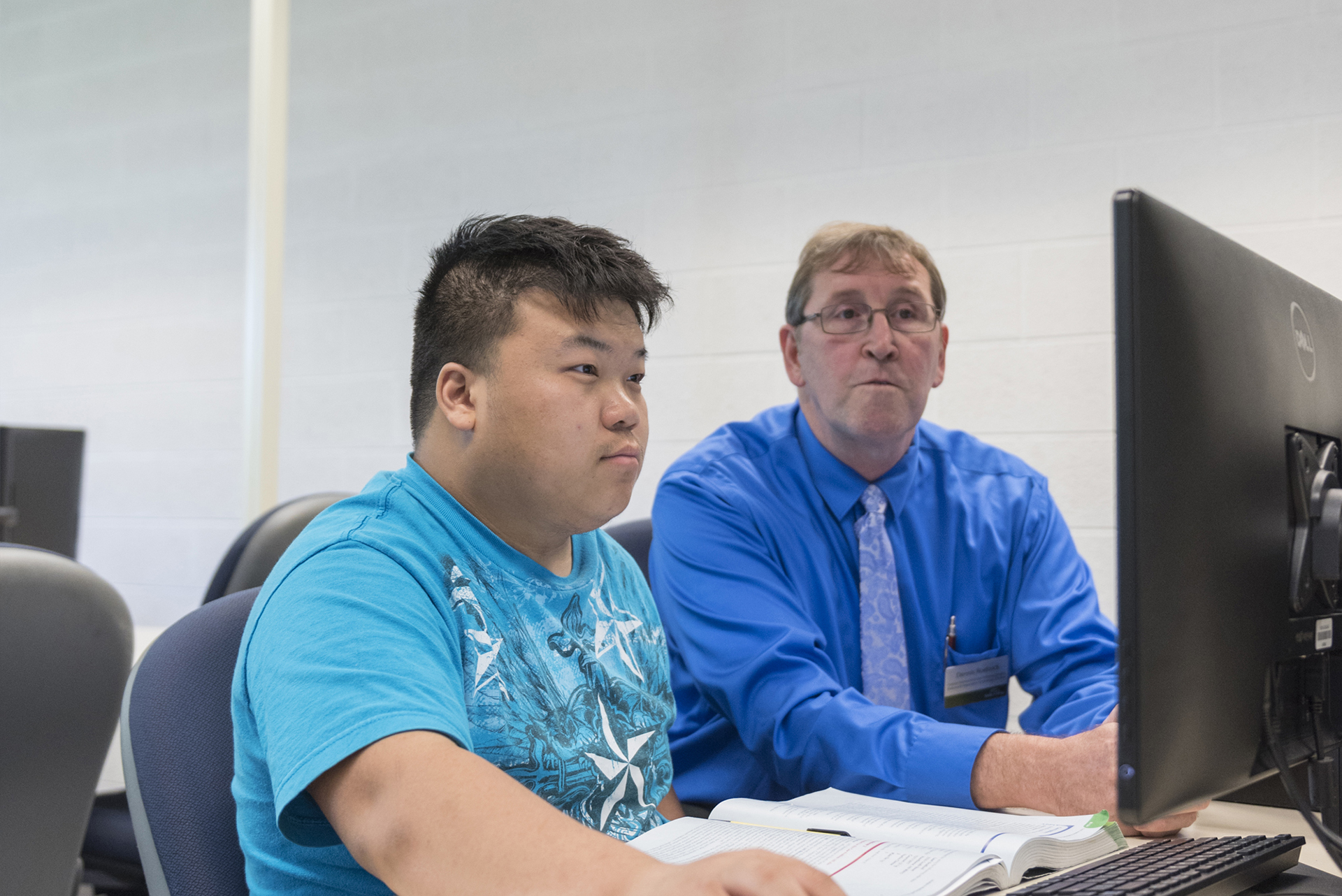 Student in computer lab with instructor