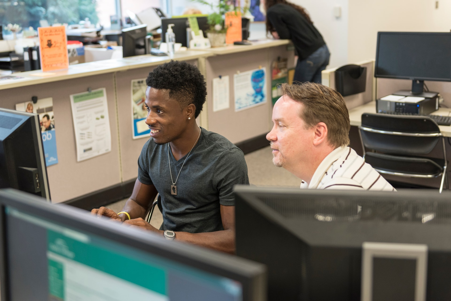 Student working on computer with an advisor