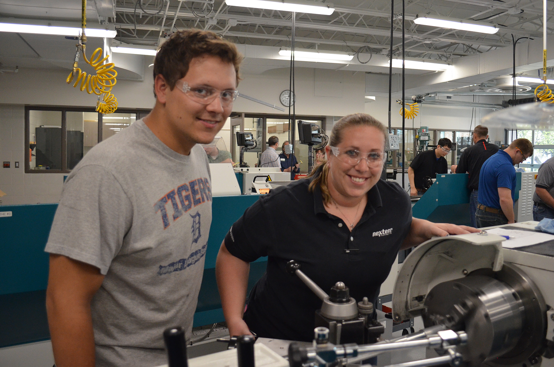 Corporate Services clients in the CNC lab