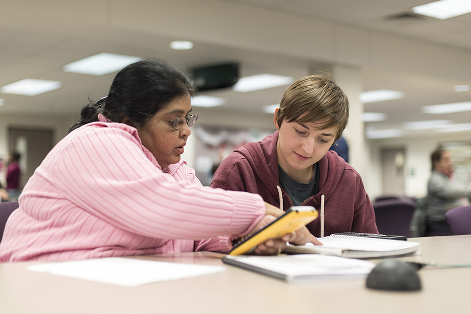 Student working with Tutor in the Library