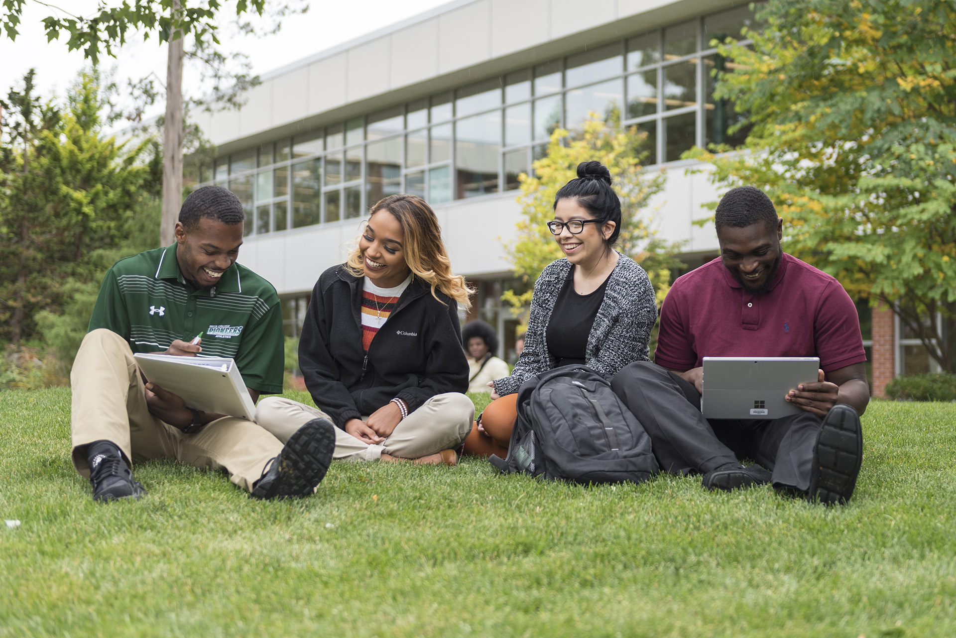 Delta College students working outside in the grass.