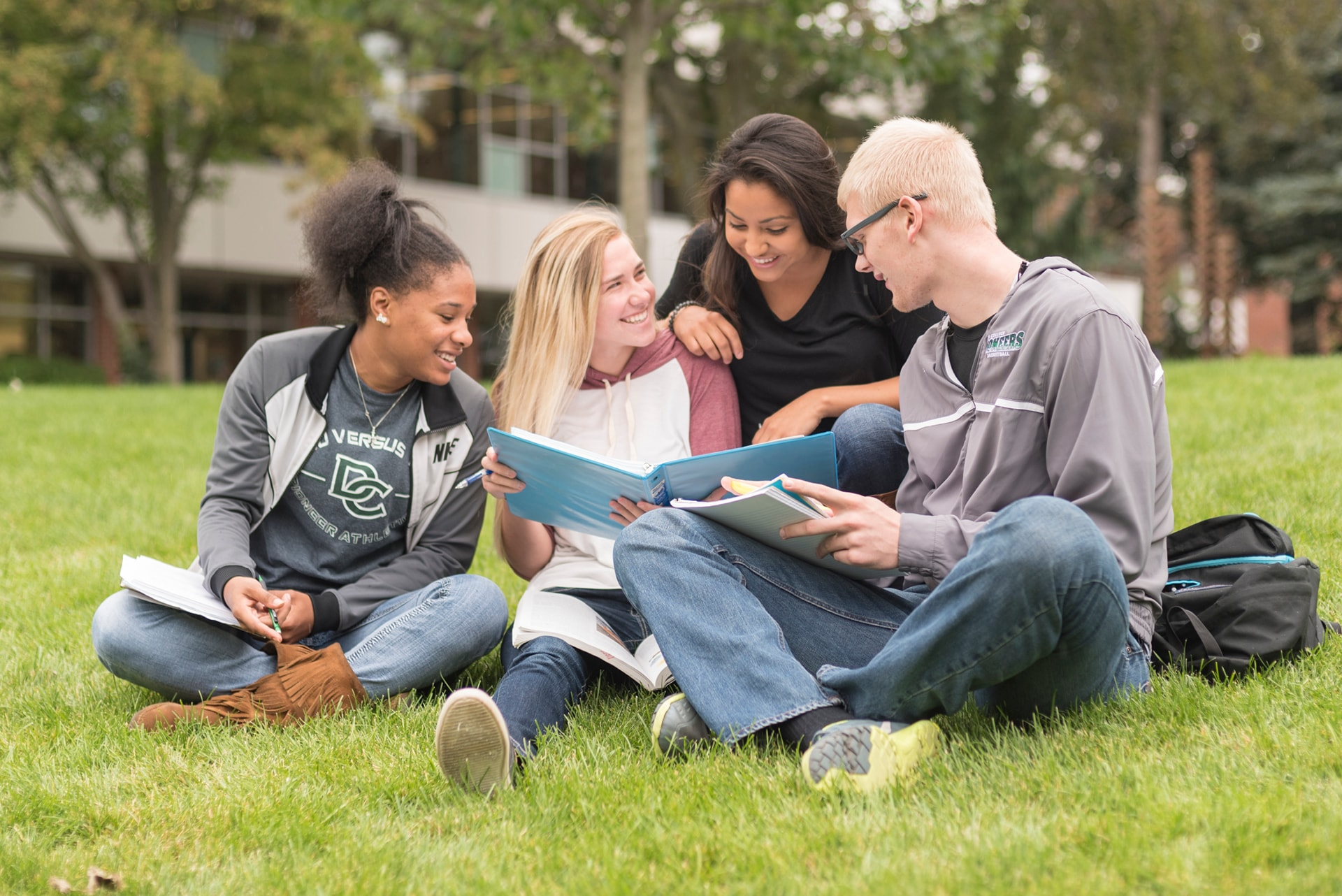 Group of students studying in courtyard