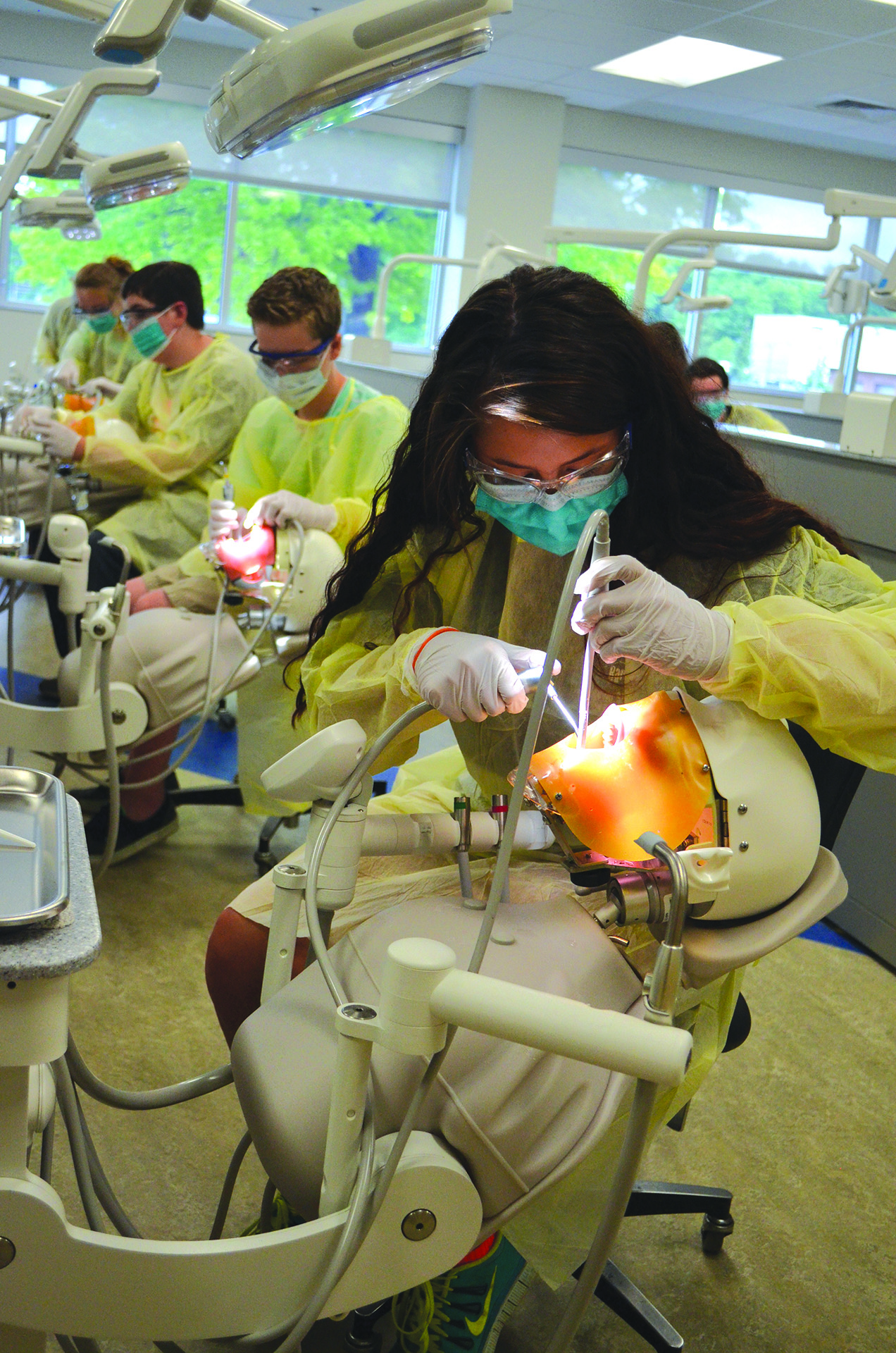 Campers working in the dental lab